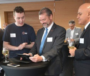 Jacob Keller, Lead Developer at Tap Into Safety doing a demo with Honourable Michael Mischin, Attorney-General of Western Australia.